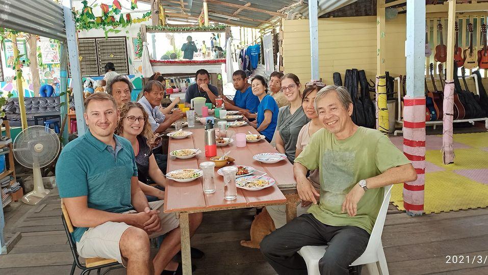 Volunteers eating together.